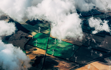 Ariel photo of wind turbines  by Thomas Richter on Unsplash